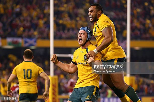 James Horwill of the Wallabies and team mate Sekope Kepu celebrate winning game two of the International Test Series between the Australian Wallabies...