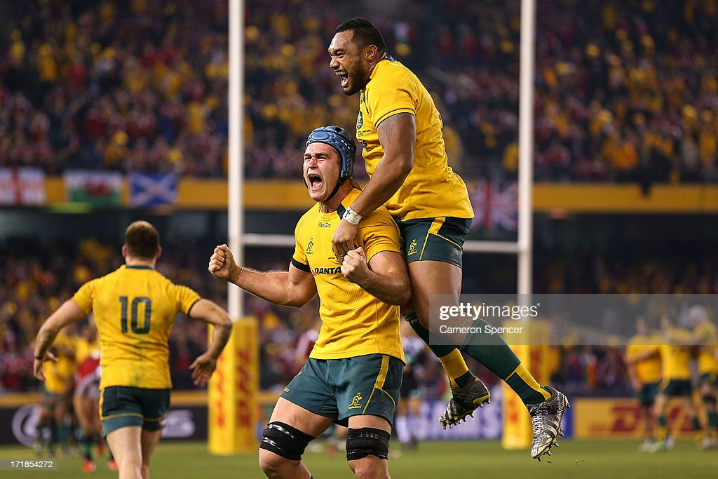 James Horwill of the Wallabies and team mate Sekope Kepu celebrate winning game two of the International Test Series between the Australian Wallabies and the British & Irish Lions at Etihad Stadium on June 29, 2013 in Melbourne, Australia.