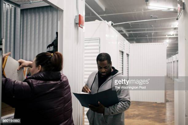 James Howlett at center and his partner Nadine search for documents they'll need to apply for assistance in Milwaukee on Friday March 2 2018 Shortly...