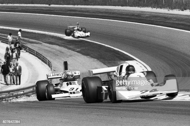 James Hunt Chris Amon HeskethFord 308B EnsignFord N175 Grand Prix of Switzerland DijonPrenois 24 August 1975