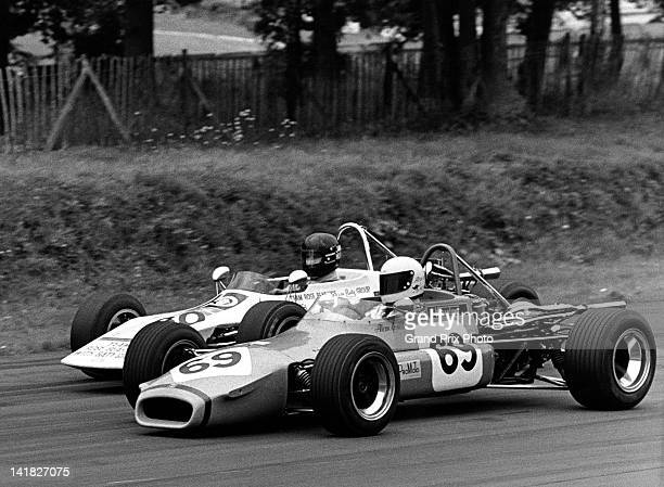 James Hunt driving the Team Rose Bearings March Racing March 713S Ford/Holbay tries to pass inside Alan Jones driving the Australian International...