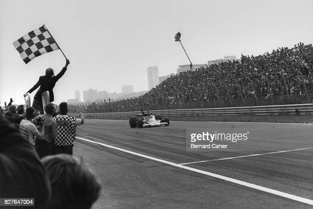 James Hunt, McLaren-Ford M23, Grand Prix of Netherlands, Zandvoort, 29 August 1976. James Hunt takes the checkered flag and his first Grand Prix...
