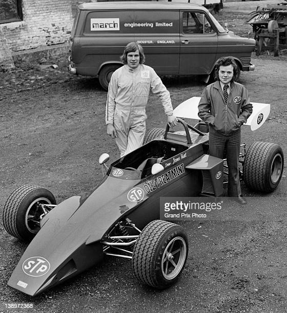 James Hunt of Great Britain and Brandan McInerney of Ireland pose with their STP March Racing Team March 723 Ford Vegantunes and Ford Transit...