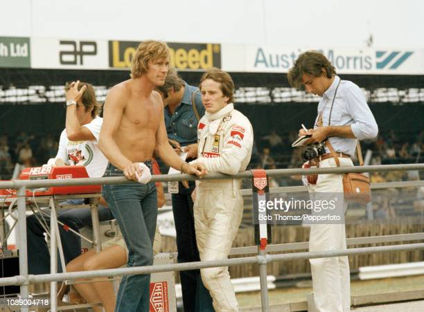 James Hunt of Great Britain and Gilles Villeneuve of Canada on the pitwall during the British Grand Prix at the Silverstone Circuit in Northampton...