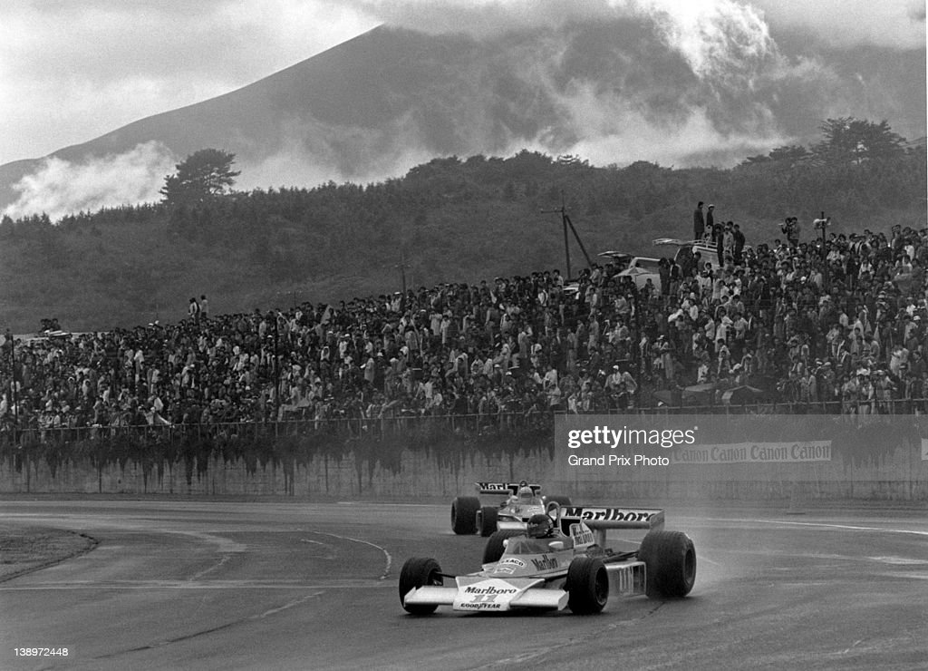 James Hunt of Great Britain drives the #11 Marlboro Team McLaren McLaren M23 Ford Cosworth V8 through the rain and with Mount Fuji in the background during the Japanese Grand Prix on 24th October 1976 at the Mount Fuji circuit, Oyama, Japan.