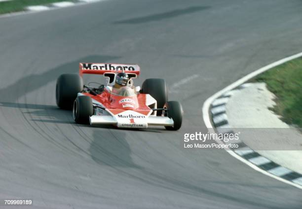 James Hunt of Great Britain, driving a McLaren M23 with a Ford Cosworth V8 engine for Marlboro Team McLaren, enroute to winning the Race of Champions...