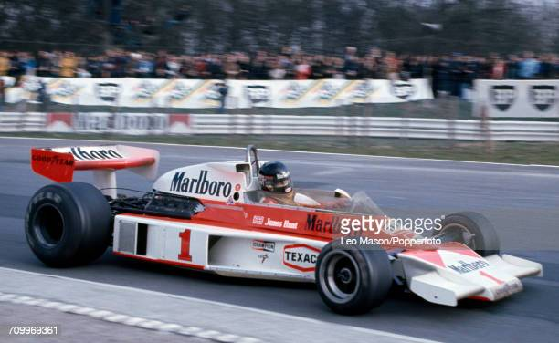 James Hunt of Great Britain driving a McLaren M23 with a Ford Cosworth V8 engine for Marlboro Team McLaren enroute to winning the Race of Champions...