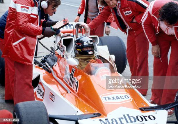 James Hunt of Great Britain, driving the Marlboro Team McLaren M26 McLaren-Cosworth Ford V8, makes a pit stop during the 1978 BRDC International...