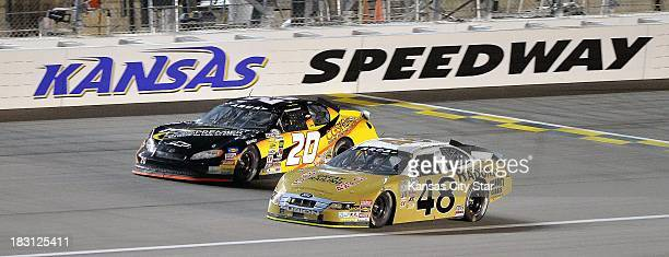 James Hylton car runs next to Tom Berte during the ARCA Racing Series race at the Kansas Speedway in Kansas City Kansas Friday October 4 2013 Hylton...