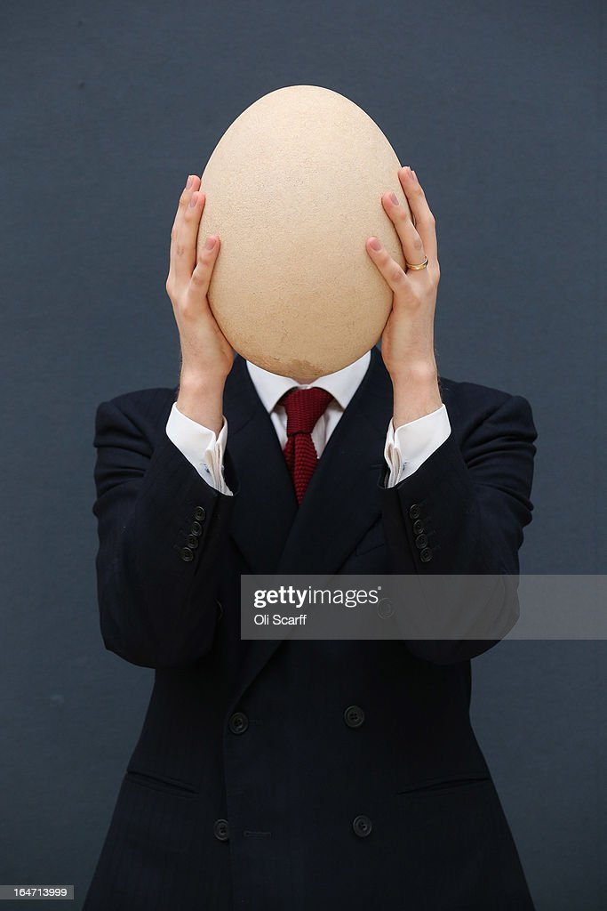 James Hyslop, a Scientific Specialist at Christie's auction house holds a complete sub-fossilised elephant bird egg on March 27, 2013 in London, England. The elephant bird egg is expected to fetch 30,000 GBP when it features in Christie's 'Travel, Science and Natural History' sale, which is to be held on April 24, 2013 in London.