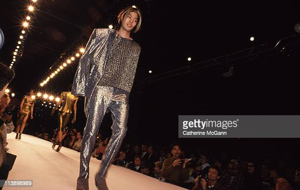 James Iha of Smashing Pumpkins models Anna Sui fashions during a fashion show in 1994 in New York City New York