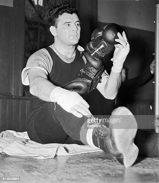 James J Braddock former heavyweight champion looks over a head gear and boxing gloves at Stillman's Gymnasium May 3 as he started conditioning for...