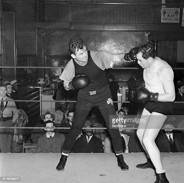 James J Braddock former heavyweight champion shown left lands a left jab to the head of a sparring partner at Stillman's Gymnasium May 3 as he...