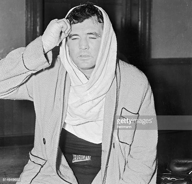 James J Braddock former heavyweight champion wiping perspiration from his forehead after a workout at Stillman's Gymnasium May 3 as he started...