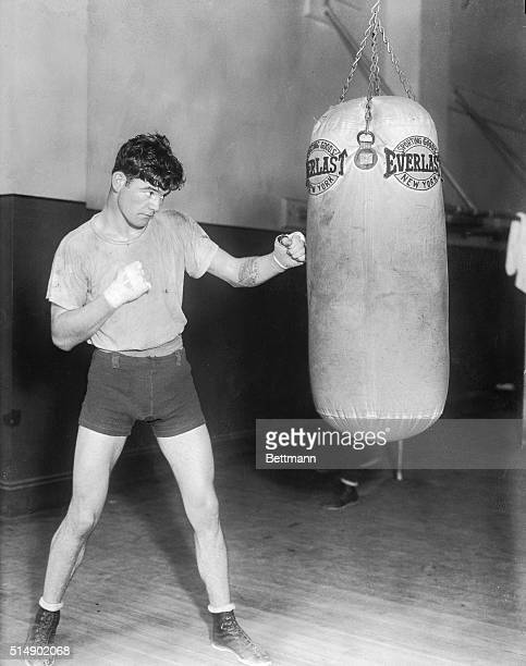 James J Braddock sails into the big bag at Stillman's gym where he's getting into condition for his scrap with Leo Lomski the Aberdeen Assassin...