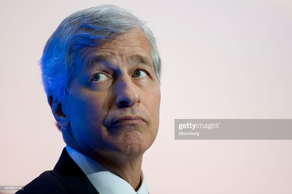 James 'Jamie' Dimon, chief executive officer of JPMorgan Chase & Co., listens during an Institute of International Finance panel discussion in Washington, D.C., U.S., on Friday, Oct. 10, 2014. Dimon, who's making his first public appearance since undergoing treatment for throat cancer earlier this year, said the biggest U.S. bank probably will double its $250 million annual computer-security budget within the next five years. Photographer: Andrew Harrer/Bloomberg via Getty Images