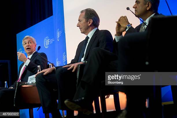 James Jamie Dimon chief executive officer of JPMorgan Chase Co left speaks during an Institute of International Finance panel discussion with James...