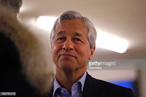 James 'Jamie' Dimon chief executive officer of JPMorgan Chase Co looks on as he speaks to an attendee between sessions during the World Economic...