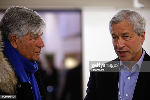 James 'Jamie' Dimon chief executive officer of JPMorgan Chase Co right speaks to Maurice Levy chief executive officer of Publicis Group SA between...