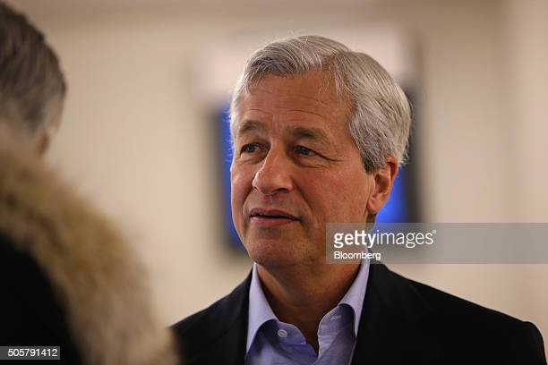 James 'Jamie' Dimon chief executive officer of JPMorgan Chase Co speaks to an attendee between sessions during the World Economic Forum in Davos...