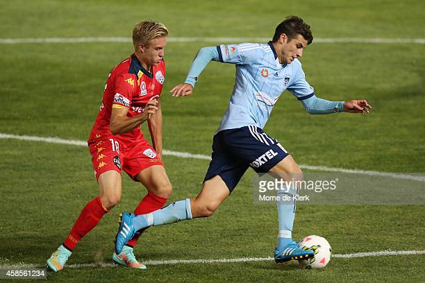 James Jeggo of Adelaide United of Adelaide United competes with Terry Antonis of Sydney during the round five ALeague match between Adelaide United...
