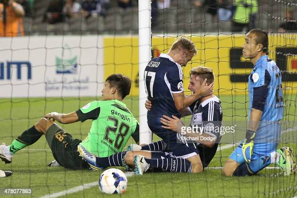 James Jeggo of the Victory hugs Nicholas Ansell who scored a goal during the AFC Asian Champions League match between the Melbourne Victory and...