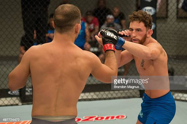 James Jenkins and Artem Lobov touch gloves during the filming of The Ultimate Fighter Team McGregor vs Team Faber at the UFC TUF Gym on August 7 2015...
