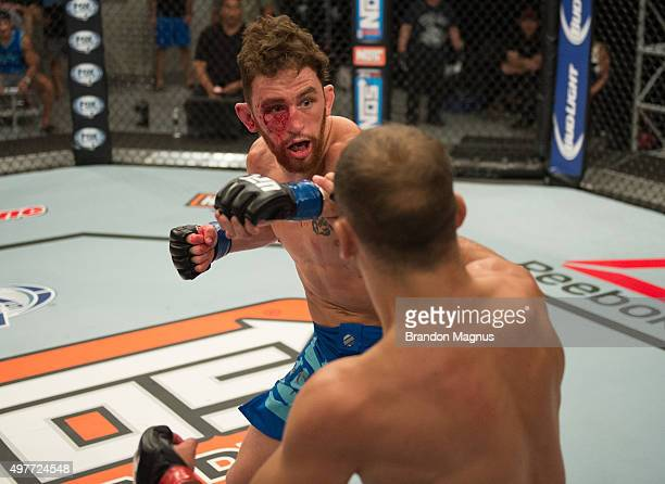 James Jenkins punches Artem Lobov during the filming of The Ultimate Fighter Team McGregor vs Team Faber at the UFC TUF Gym on August 7 2015 in Las...