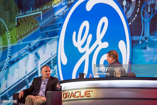 James Jim Fowler chief information officer for General Electric Co left speaks as Mark Hurd copresident and cochief executive officer of Oracle Corp...