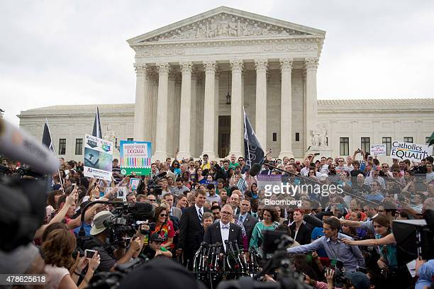 James Jim Obergefell named plaintiff in the Obergefell v Hodges case bottom center speaks to the media after the samesex marriage ruling outside the...