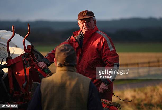 James Jobson from Hartlepool chats to a fellow competitor during the annual ploughing match on November 27, 2016 in Staithes, United Kingdom. The...