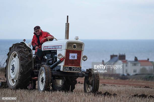 James Jobson from Hartlepool drives his David Brown 990 tractor as he takes part in the annual ploughing match on November 27, 2016 in Staithes,...