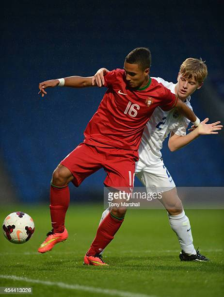 James John Yates of England tackles Centeno of Portugal during the Under 17 International match between England U17 and Portugal U17 at Proact...