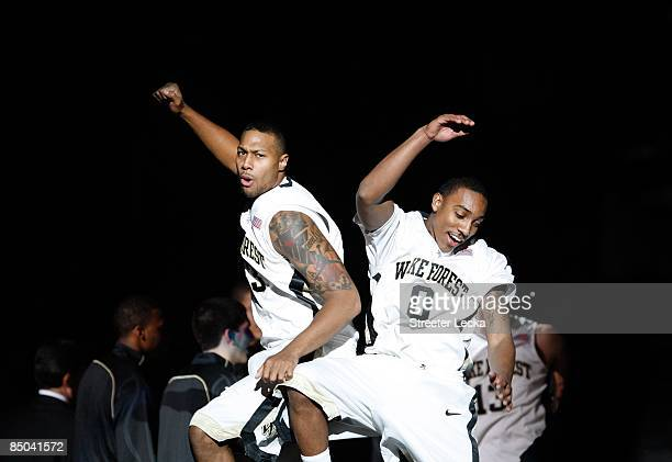 James Johnson and Jeff Teague of the Wake Forest Demon Deacons jump during pregame introductions before their game against the Georgia Tech Yellow...