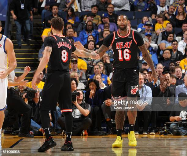 James Johnson and Tyler Johnson of the Miami Heat high five during the game against the Golden State Warriors on November 6 2017 at ORACLE Arena in...