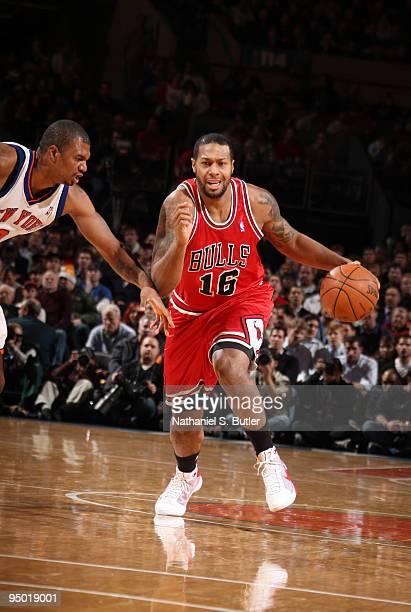 James Johnson of the Chicago Bulls drives against Jonathan Bender of the New York Knicks on December 22 2009 at Madison Square Garden in New York...