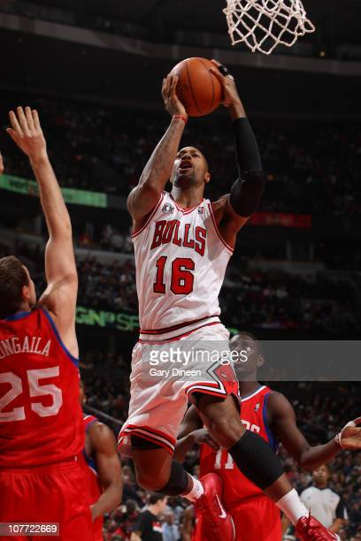 James Johnson of the Chicago Bulls shoots against Darius Songalia of the Philadelphia 76ers in a game on December 21 2010 at the United Center in...