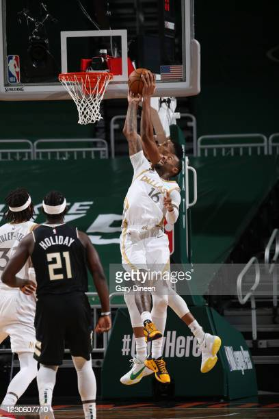 James Johnson of the Dallas Mavericks reaches for the rebound during the game against the Milwaukee Bucks on January 15, 2021 at the Fiserv Forum...