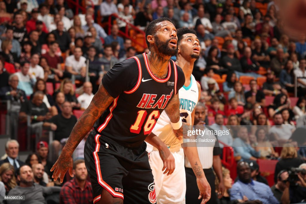James Johnson #16 of the Miami Heat and Jeremy Lamb #3 of the Charlotte Hornets react to a play during the game on December 1, 2017 at American Airlines Arena in Miami, Florida.