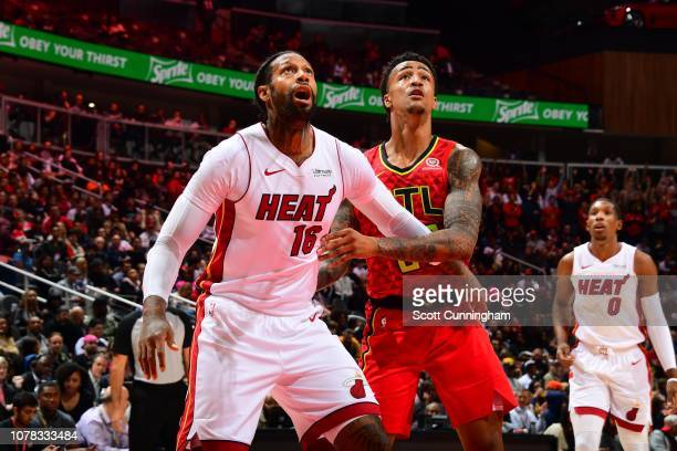 James Johnson of the Miami Heat and John Collins of the Atlanta Hawks fight for the rebound on January 6 2019 at State Farm Arena in Atlanta Georgia...