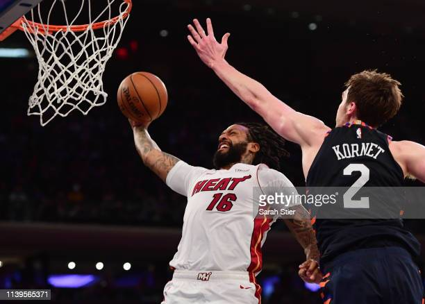 James Johnson of the Miami Heat attempts a dunk against Luke Kornet of the New York Knicks during the first half of the game at Madison Square Garden...