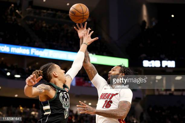 James Johnson of the Miami Heat attempts a shot while being guarded by DJ Wilson of the Milwaukee Bucks in the third quarter at the Fiserv Forum on...