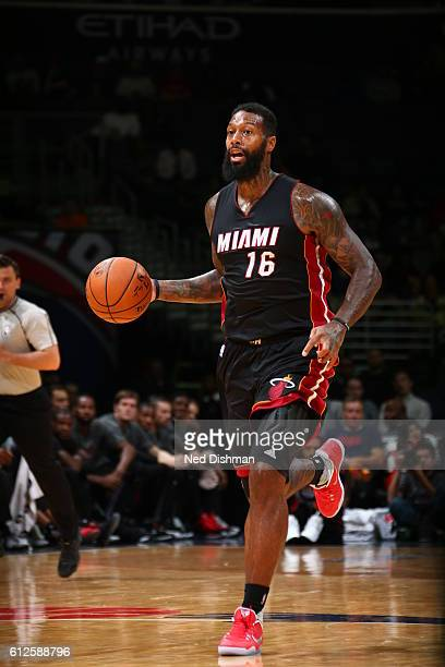James Johnson of the Miami Heat brings the ball up court against the Washington Wizards during a preseason game on October 4 2016 at Verizon Center...