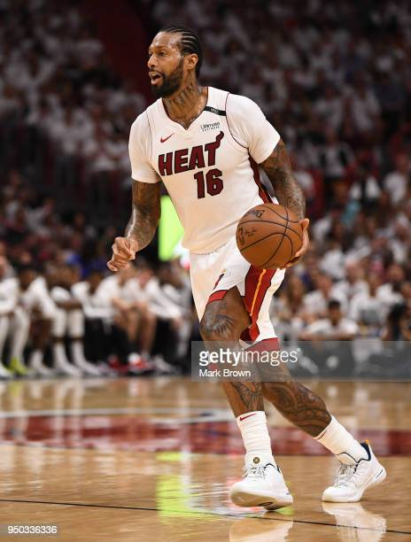 James Johnson of the Miami Heat brings the ball up the court in the third quarter against the Philadelphia 76ers during Game Four of Round One of the...