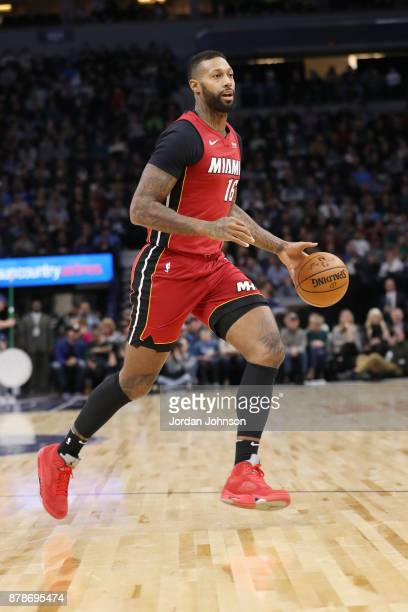 James Johnson of the Miami Heat dribbles the ball against the Minnesota Timberwolves on November 24 2017 at Target Center in Minneapolis Minnesota...