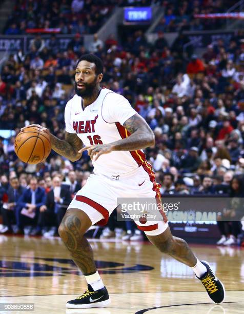 James Johnson of the Miami Heat dribbles the ball during the first half of an NBA game against the Toronto Raptors at Air Canada Centre on January 9...
