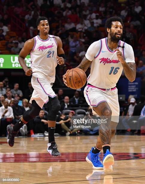 James Johnson of the Miami Heat dribbling up the court with Hassan Whiteside during the game against the Oklahoma City Thunder at American Airlines...