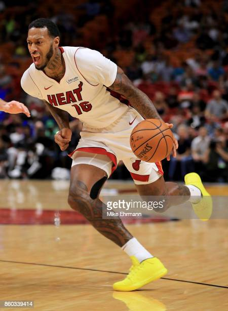 James Johnson of the Miami Heat drives during a preseason game against the Washington Wizards at American Airlines Arena on October 11 2017 in Miami...