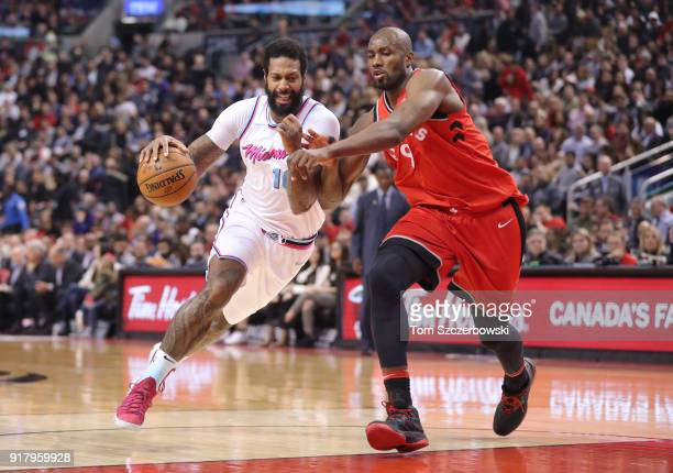 James Johnson of the Miami Heat drives to the basket against Serge Ibaka of the Toronto Raptors at Air Canada Centre on February 13 2018 in Toronto...