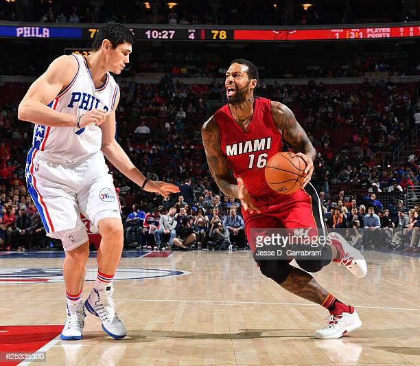 James Johnson of the Miami Heat drives to the basket against the Philadelphia 76ers at Wells Fargo Center on November 21 2016 in Philadelphia...
